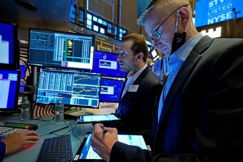 تذبذب في الأسهم الأمريكية قبل بيان المركزي الأمريكي